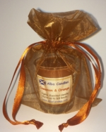 Cinnamon and orange Alba candle in a brown gift bag